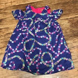 Gorgeous print, peekaboo sleeve toddler dress.